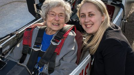 99-year-old Olwyn Hopkins with Davers Court lifestyle coordinator Katie Ramsbotham before her glider