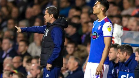 Substitute Andre Dozzell waits to come on as Town manager Paul Hurst gives instruction on Tuesday.