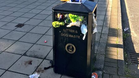 A full litter bin at St Olaves Precinct in Bury St Edmunds. An application for another takeaway at t