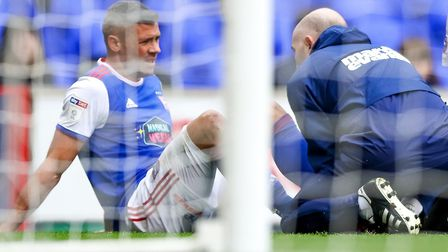 Physio Matt Byard treats Jonathan Walters after he had pulled up with injury. Picture: STEVE WALL