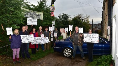 People living in Long Row in Leiston pictured during a previous protest over the new housing Picture