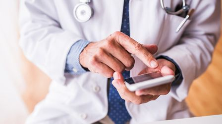 Doctor-on-phone---GettyImages-