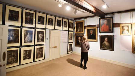 A gallery-goer enjoying looking at one of the paintings. Picture: GREGG BROWN