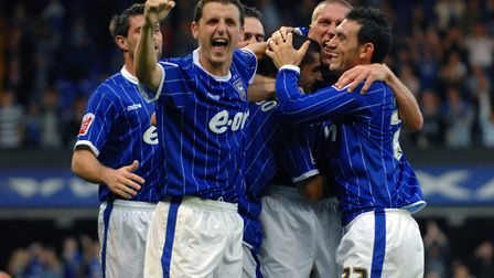 Ipswich celebrate their fourth goal against Coventry