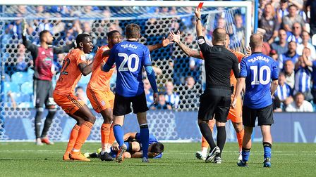 Toto Nsiala and the rest of the Ipswich defence show their disbelief at being shown the red card Pic