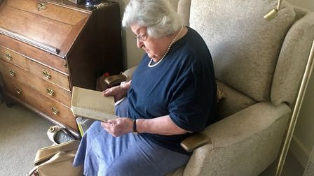 Eleanor looks through her flight log book. The 101-year-old is Britain's last surviving female pilot