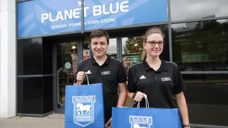 Planet Blue staff Rachel Macro and Nathan Gunner with the new paper bags Picture: DAVID VINCENT
