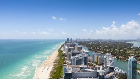 View of Miami facing south from Collins and 63rd with South Beach on the left and the city on the ri