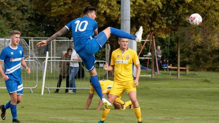George Clarke steers home the winner for Brantham Athletic against Spalding United in the previous r