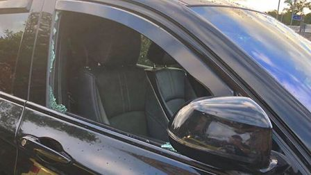 The smashed window of the BMW Picture:AGNES KENJI