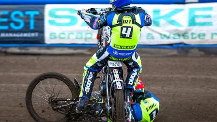 Michael Hartel (blue helmet) and team-mate Danny King crash in the first heat of the Ipswich v Lakes