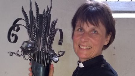 Revd Janet Nicholls, Essex rural adviser and agricultural chaplain, with the National Harvest Torch