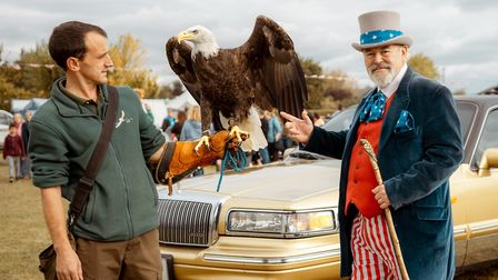 Event Mascot 'Uncle Sam' and 'Lincoln' the Bald Eagle infront of a Lincoln Limo at the American Car