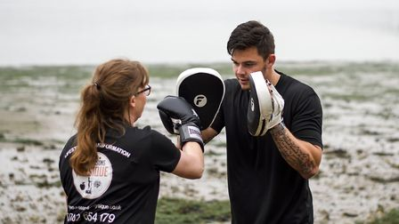 Lifestyle transformation coach Danny Rose shows Catherine Linsell some boxing PICTURE: Four Seasons