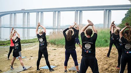 The Four Seasons Physique team doing a yoga cooldown at their recent team workout PICTURE: Four Seas