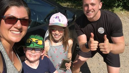 Lead coach Luke Hall and member Christina Lofthouse and two of her children posing post workout! PIC
