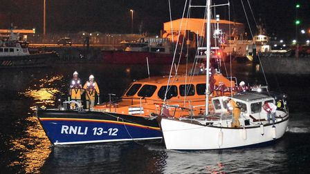 The Lowestoft RNLI escort the yacht into safe harbouyr Picture: MICK HOWES