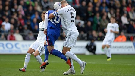 Freddie Sears goes for a header with Van Der Toorn and the ball ends up in the back of the Swansea C