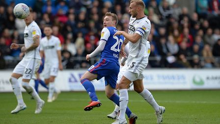 Freddie Sears goes for a header with Mike van der Hoorn and the ball ends up in the back of the Swan