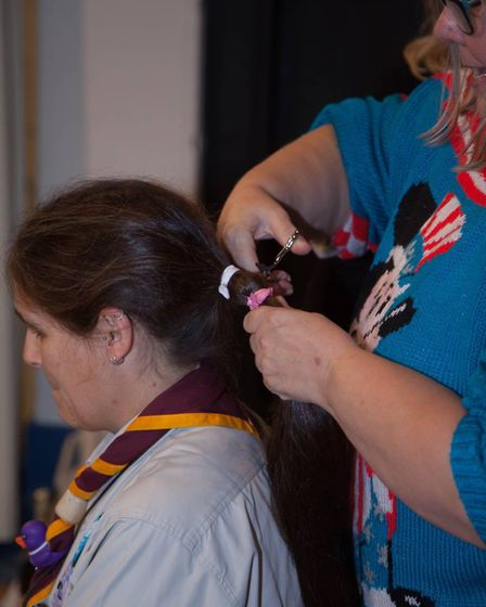 The first snip removed Ruth's long ponytail that will be used to make wigs for children with cancer.