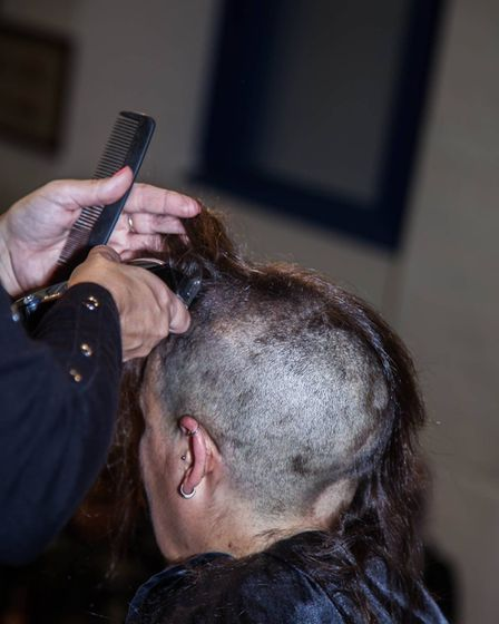 Ruth was nervous before the chop but was determined to raise money for her scout group. Picture: PET