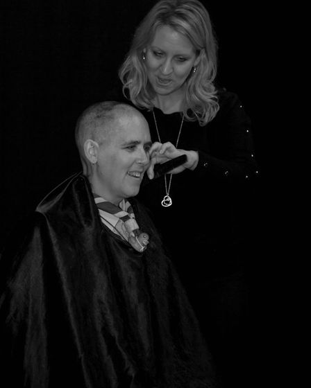 Hairdresser Helen Stockton used a razor to give Ruth a buzz cut. Picture: PETE INMAN
