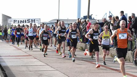 Runners along the sea front, taking part in the Lowestoft Half-Marathon, including eventual runner-u