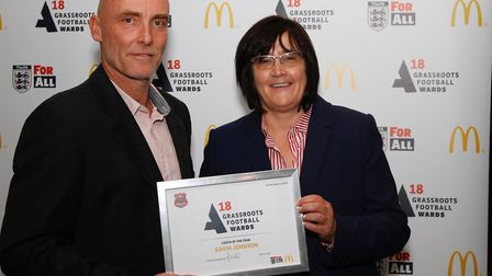 Gavin Johnson, left, of Stowupland Falcons FC receives the Coach of the Year award from McDonald�s f