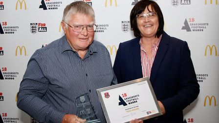 Tony Adams, left, of Claydon FC receives the Volunteer of the Year award from McDonald�s franchisee