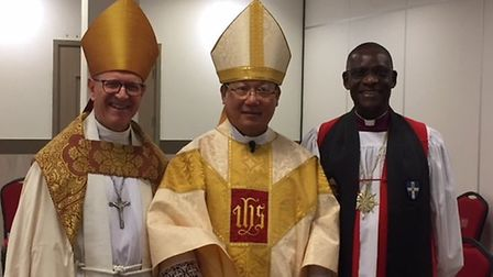 Left, Bishop Martin Seeley with, centre, his host, the Archbishop of Hong Kong, the Most Rev Paul Kw