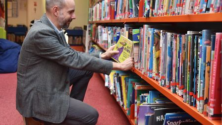 Paul Howarth picking out a book at Ipswich County Library Picture: SONYA DUNCAN
