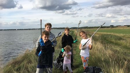 Isaac, Ben and Joe Mathison with Jessica and Emily Allen collected rubbish at Suffolk Wildlife Trust
