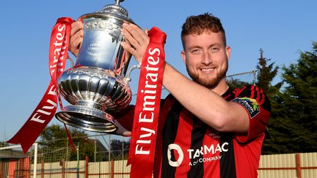 Brightlingsea Regent captain Matt Cripps with the FA Cup trophy at the Taydal Stadium (North Road).
