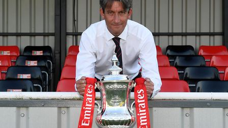 Brightlingsea Regent chairman Terry Doherty with the FA Cup trophy. Picture: ALAN WALTER/THE FA