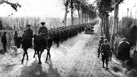 The Gloucestershire Regiment marching through Piave on the way to the front at Asiago.