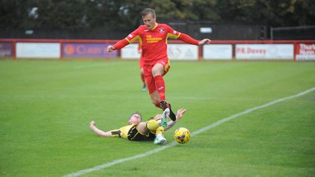 Dan Morphew is tackled by a Rushden player. Picture: BEN POOLEY