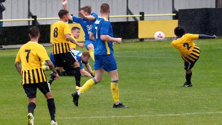 Ollie Brown's shot is handled by Histon's Matt Green (arms in air) to concede a penalty. Picture: PA