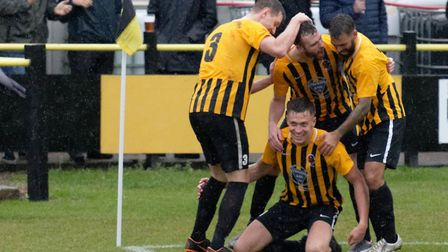 Josh Mayhew celebrates his equaliser for Stowmarket in their home draw with Histon. Picture: PAUL VO