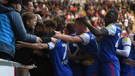 Trevoh Chalobah is mobbed by team-mates and supporters following his winning goal at Swansea. Photo: