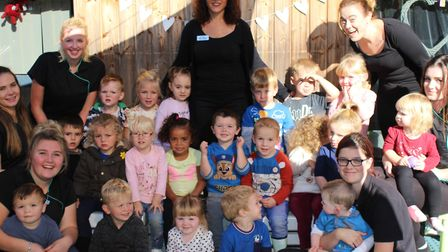 Staff and children at Springfields Day Nursery celebrate the 'outstanding' Ofsted rating Picture: SP