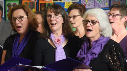 Members of the Upbeat Contemporary Choir take part in Bildeston Primary School's sing along with tun