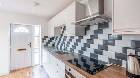 The kitchen of the bungalow in Lakenheath, which is available for £140,000. Picture: ABBOTTS