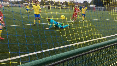 Haringey Borough keeper Valery Pajetat is powerless to prevent AFC Sudbury from taking the lead via