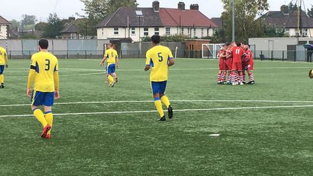 AFC Sudbury players (red shirts) celebrate taking an early lead at Haringey Borough in the FA Cup th
