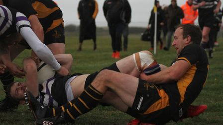 Richard Thickett makes a tackle for Southwold. Picture: LINDA CAYLEY