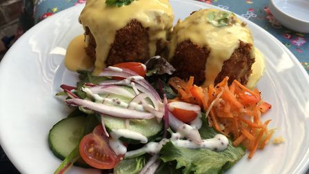 Fishcakes with hollandaise sauce, salad and coleslaw Picture: Archant