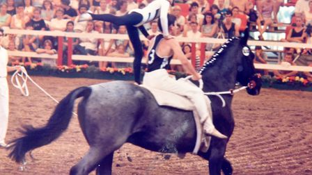 Amanda Melton, a former national and international equine vaulting competitor, competed in the World