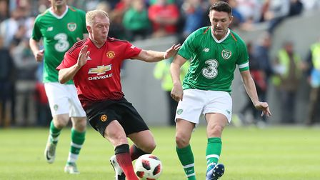 Robbie Keane (right) battles with Paul Scholes (left) in a charity match earlier this summer. Photo:
