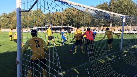 Goalmouth action as Mildenhall prepare to defend a corner, during the first half at Ram Meadow. Pict
