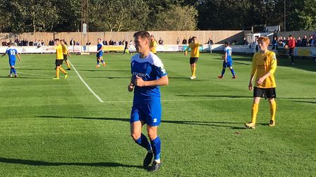 Bury Town right-back, Jake Kerins, in action during the West Suffolk derby against Mildenhall Town.